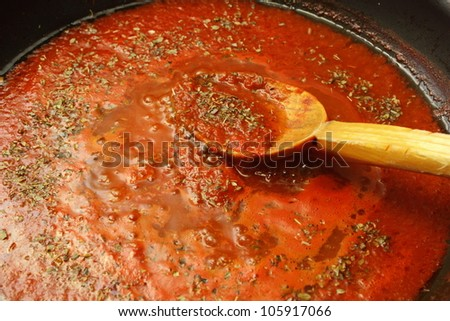 making pizza sauce with tomatoes and oregano - stock photo