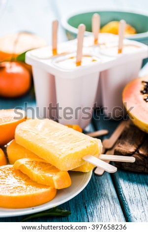 making popsicle, frozen sorbet for summer at home - stock photo
