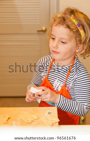 Making shortbread cookies together at home before Christmas. - stock photo