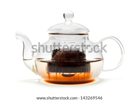 making tea in a glass teapot, isolated on white - stock photo