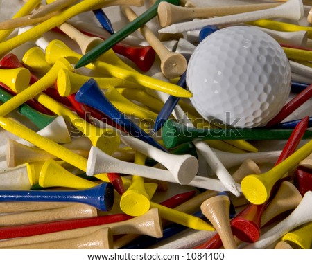 Making the choice of which color of tee to use for golf - stock photo