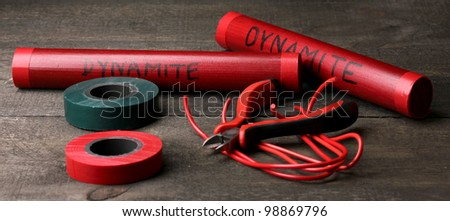 Making timebomb on wooden table on black background - stock photo