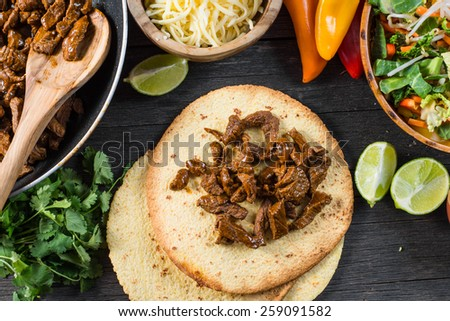 making typical latin street food, mexican taco - stock photo