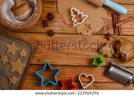 Making variety of Christmas cookies on table - stock photo
