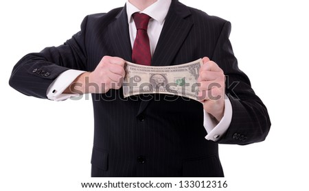 making your money go further, businessman stretching out a dollar isolated on white - stock photo