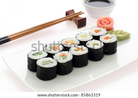 Makizushi. Delicious sushi rolls on white plate with chopsticks and wasabi. Maki - stock photo