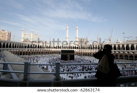 MAKKAH - APRIL 24 : A woman Muslimah takes photo of Kaaba at Masjidil Haram on April 24, 2010 in Makkah, Saudi Arabia. Muslims all around the world face the Kaaba during prayer time. - stock photo