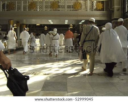 MAKKAH-JAN 1:Pilgrims perform 'saei' (brisk walking between the hills of Safa & Marwah 7 times) Jan 1, 2008 in Makkah. The ritual is a reenactment of Abraham's wife, Hajr frantic search for water - stock photo