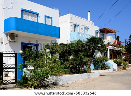 MAKRIGIALOS, CRETE - SEPTEMBER 18, 2016 - Row of whitewashed Greek townhouses, Makrigialos, Crete, Greece, Europe, September 18, 2016.