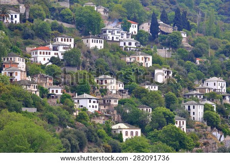 Makrinitsa village with traditional stone houses scattered n the mountain side, Pelion peninsula, Greece - stock photo