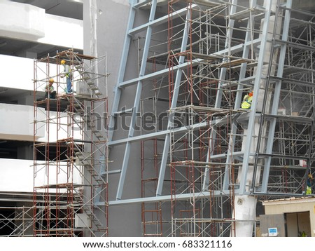 MALACCA, MALAYSIA -APRIL 07, 2017: Scaffolding used as the temporary structure to support platform, form work and structure at the construction site. Also used it as a walking platform for workers.