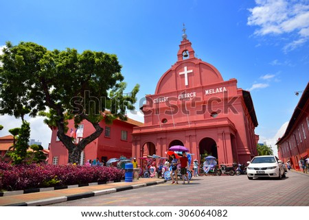 MALACCA, MALAYSIA - AUG 7, 2015: Day view of Christ Church & Dutch Square in Malacca City, Malaysia. It was built in 1753 by Dutch & is the oldest 18th century Protestant church in Malaysia. - stock photo
