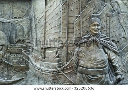 MALACCA, MALAYSIA-CIRCA SEPT 2015:Street Mural of Admiral Cheng Ho and ships on Sep,2015 in Malacca, Malaysia. Admiral Cheng Ho is a famous figure in Malacca's history. - stock photo