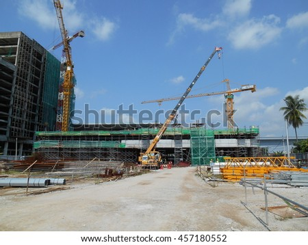 MALACCA, MALAYSIA -JUNE 13, 2016: Construction site in progress at MALACCA, Malaysia during daytime. Workers busy with their task such as installing form work and reinforcement bar.