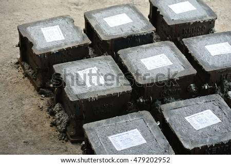 MALACCA, MALAYSIA -SEPTEMBER 03, 2016: Cube test. Steel mold in square shape used to get standard square shape concrete block. The concrete block will be used for compression test in laboratory.