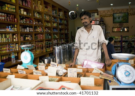 MALACCA - OCTOBER 31: An Indian shop assistant waiting for customers in a grocery and spices shop in the historic city of Malacca.  October 31, 2009 in Malaysia.