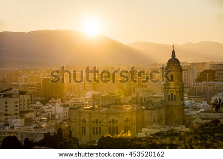Malaga Cathedral and city at Sunset Spain - stock photo