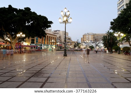 MALAGA, SPAIN- AUGUST 21, 2014:The resort town on the Costa del Sol (Coast of the Sun) and tourists at night, Malaga in Andalusia, Spain