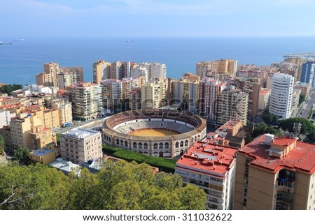 Malaga, Spain. Cityscape with hotels and bullring stadium. - stock photo