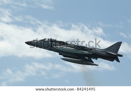 MALAGA (SPAIN) - 28 MAY: Celebration of Armed Forces Day at the beach of La Malagueta. Aircraft AV-8B Plus Harrier II making a stationary flight on the airshow on 28 May 2011 in Malaga, Spain - stock photo