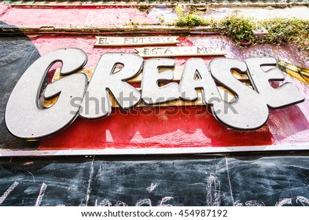 MALAGA,SPAIN - 28 MAY 2016: GREASE signboard on wall. UPHO Festival.