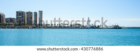 MALAGA,SPAIN - 28 MAY 2016: Panoramic view on Malaga port in sunlight - stock photo