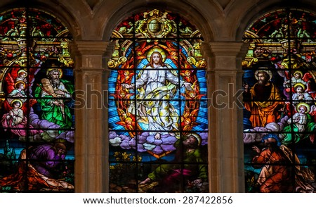 MALAGA, SPAIN - NOVEMBER 29, 2013: Stained glass window depicting Jesus, Moses and Saint Paul, in the cathedral of Malaga, Spain. - stock photo