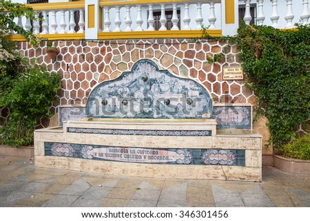 MALAGA, SPAIN - OCTOBER 28, 2015: One of the traditional fountains of Almogia, this one located at City Hall plaza - stock photo