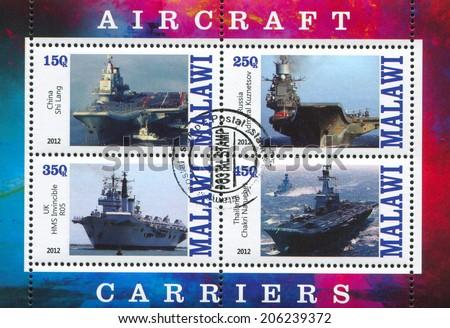 MALAWI - CIRCA 2012: stamp printed by Malawi, shows aircraft carrier, circa 2012 - stock photo