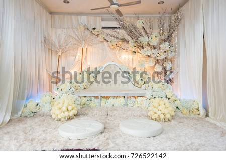 Malay Bride And Groom Pelamin For Their Wedding Day Reception Decorated With Soft Colours