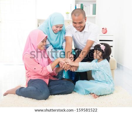 malay family teamwork theme on home - stock photo
