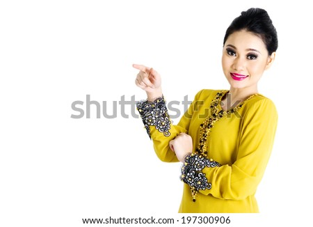 Malay woman pointing her finger on the side - stock photo