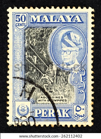 MALAYA - CIRCA 1957: Blue color postage stamp printed in Perak (Federation of Malaya) with illustrative image of aborigines with blowpipes and portrait of Sultan Yussuf Izzuddin Shah. - stock photo