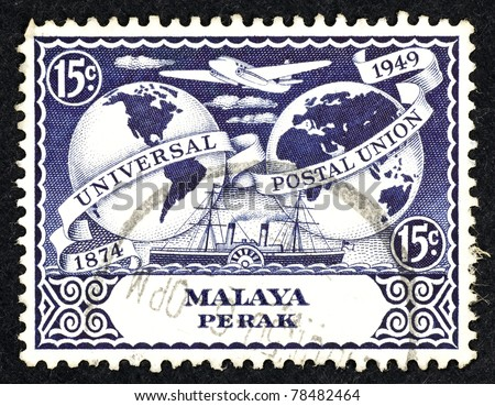 MALAYA - CIRCA 1949: Stamp printed in Malaya showing an airplane, steamship and the globe to commemorate 75years of Universal Postal Union for the strait settlement in the state of Perak, circa 1949. - stock photo
