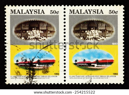 MALAYSIA - CIRCA 1993: A pair of colorful postage stamp printed in Malaysia with image of the Royal Selangor Golf Club to commemorate the 100th Anniversary of the club. - stock photo
