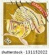 MALAYSIA - CIRCA 1997: A stamp printed in Malaysia shows Scleropages formosus (Arowana), circa 1997 - stock photo