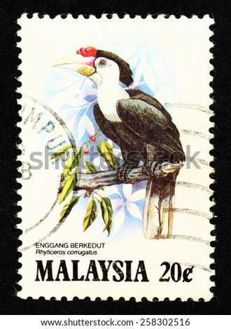 MALAYSIA - CIRCA 1983: Postage stamp printed in Malaysia with image of a Wrinkled Hornbill bird (Rhyticeros corrugatus) for the Hornbills of Malaysia series.