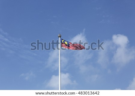 Malaysia flag also known as Jalur Gemilang wave with the blue sky. People fly the flag in conjunction with the Merdeka Day celebration on 31 August and Hari Malaysia on 16 September.