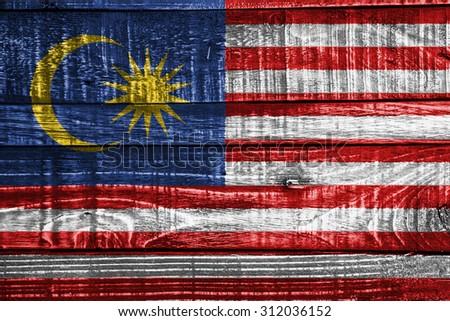Malaysia flag on wood texture background - stock photo