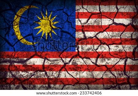 Malaysia flag pattern on the crack soil texture ,retro vintage style - stock photo
