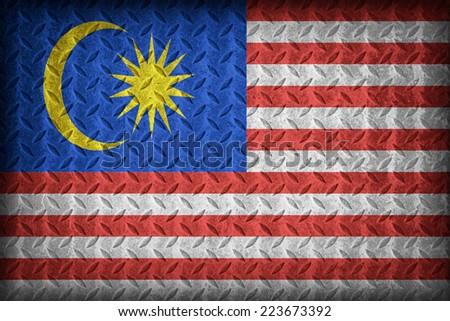 Malaysia flag pattern on the diamond metal plate texture ,vintage style - stock photo