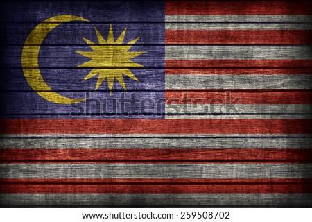 Malaysia flag pattern on wooden board texture ,retro vintage style - stock photo