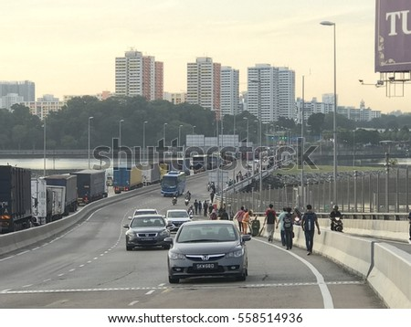MALAYSIA,JAN 18 2017: People walking to cross the causeway early morning to go to work in Singapore.