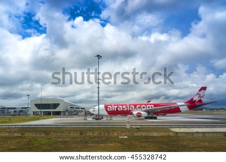 MALAYSIA-18 JULY 2016 - AirAsia Terminal in Kuala Lumpur Airport and storm clouds landscape. AirAsia is one of famous low cost airplanes at new Kuala Lumpur International Airport 2 terminal (KLIA 2).