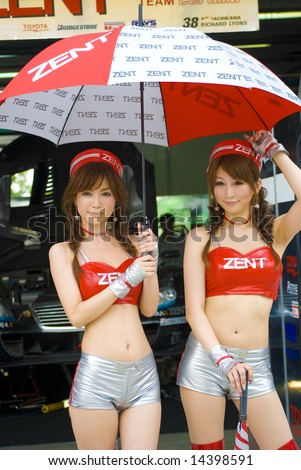 MALAYSIA - JUNE 21: GT Club's models pose for the Super GT International Malaysia Series 2008 June 21, 2008 at Sepang Circuit, Malaysia. The event features road cars. - stock photo
