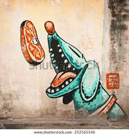 MALAYSIA, PENANG, GEORGETOWN - CIRCA JUL 2014: Large mural of a blue, cartoon style dog catching a steak in the air - stock photo