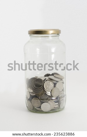 Malaysian coin in glass container shoot in whiite studio