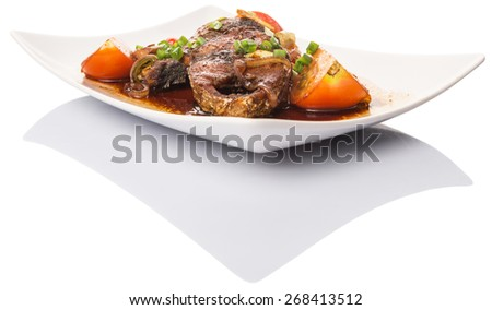 Malaysian dish deep fried mackerel tuna fish with soy sauce in white plate over white background - stock photo