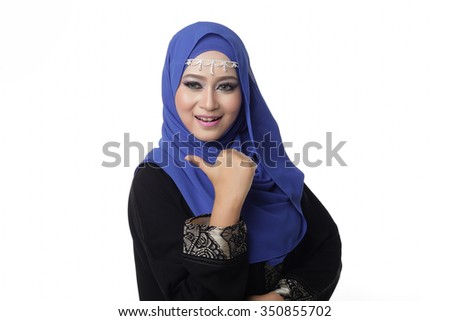 Malaysian malay woman showing good hand sign with smile expression - stock photo