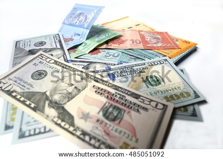 Malaysian ringgit and United States Dollar on a white background